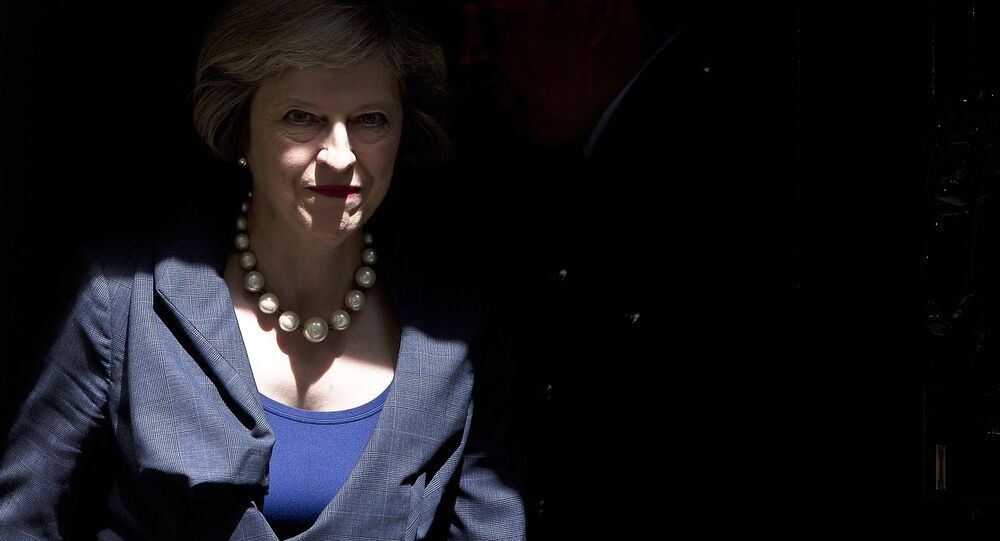 British Prime Minister Theresa May exits 10 Downing Street in London on July 26, 2016.