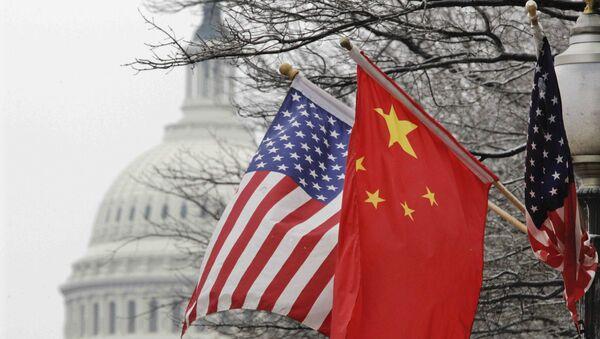 Chinese and U.S. flags. (File) - Sputnik International