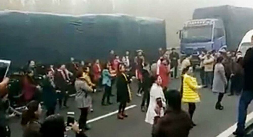 Chinese women dance in a traffic jam