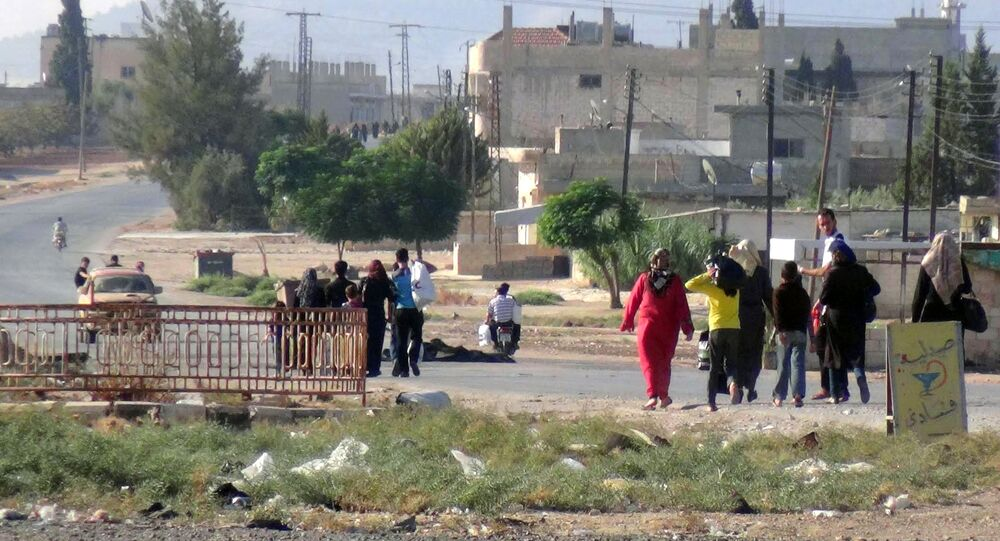 Civilians leaving the town of Suran, in Hama province, Syria (File)