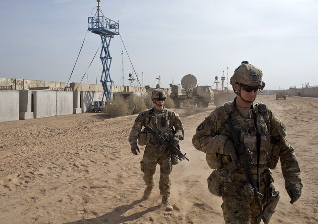 U.S. Army soldiers move through Qayara West Coalition base in Qayara, some 50 kilometers south of Mosul, Iraq, Wednesday, Nov. 9, 2016