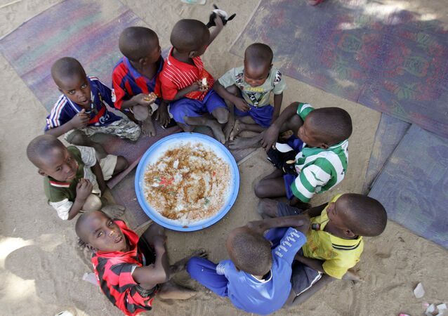 Children eat at an orphanage serving as the temporary home of 103 chidren at the centre of an abduction row in Abeche (File)