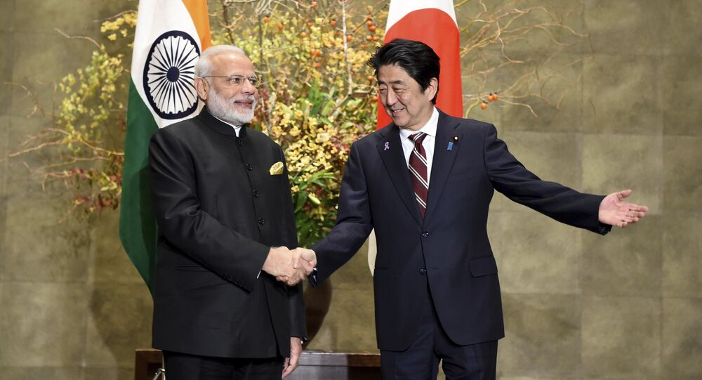 Indian Prime Minister Narendra Modi, left, is welcomed by his Japanese counterpart Shinzo Abe.