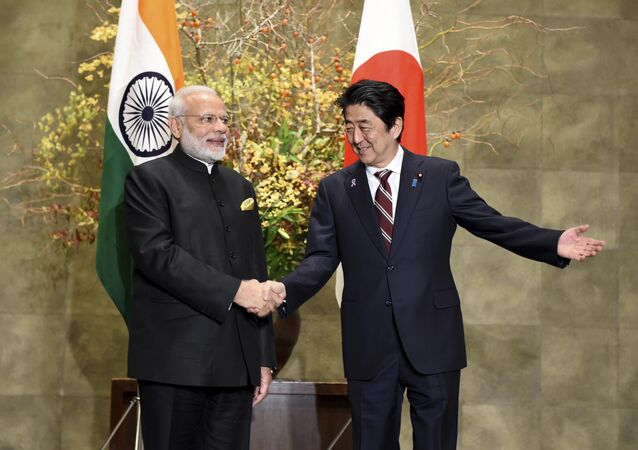 Indian Prime Minister Narendra Modi, left, is welcomed by his Japanese counterpart Shinzo Abe upon his arrival for their meeting at Abe's official residence in Tokyo, Friday, Nov. 11, 2016
