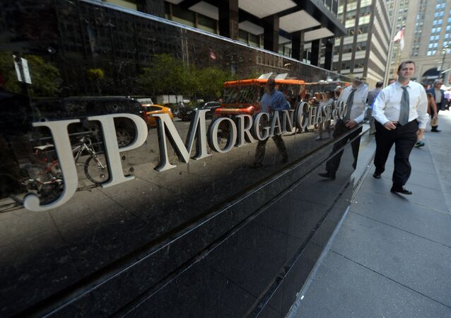People walk by JP Morgan Chase & Company headquarters in New York (File)
