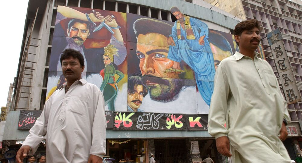 Passers-by walk in front of a movie theater in Karachi, Pakistan (File)