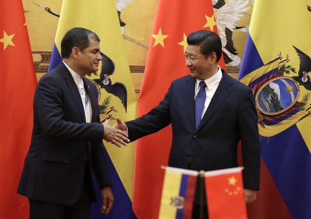 Chinese President Xi Jinping (R) shakes hands with Ecuador's President Rafael Correa after they witnessed a signing ceremony at the Great Hall of the People in Beijing (File)