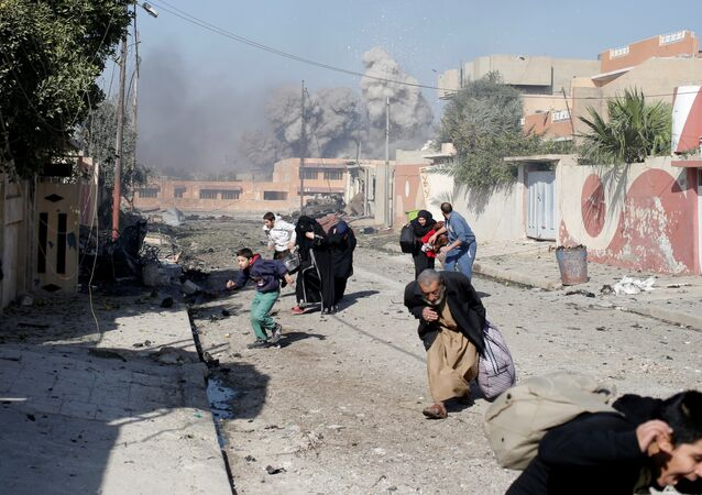 People run in panic after a coalition airstrike hit Islamic State fighters positions in Tahrir neighbourhood of Mosul, Iraq, November 17, 2016