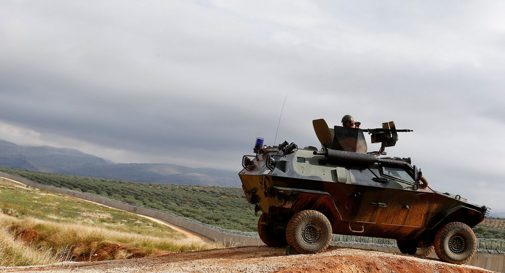 A Turkish soldier on armoured military vehicle patrols the border between Turkey and Syria, near the southeastern village of Besarslan, in Hatay province, Turkey, November 1, 2016