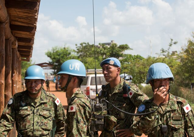 Japanese United Nations Mission in the Republic of South Sudan (UNMISS) troops wait for the arrival of the Japanese minister of defence at the UNMISS base in Tomping Juba on October 8, 2016