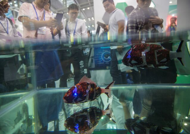 Fish robots swim in a pool during China Hi-Tech Fair in Shenzhen, China, November 16, 2016. Picture taken November 16, 2016
