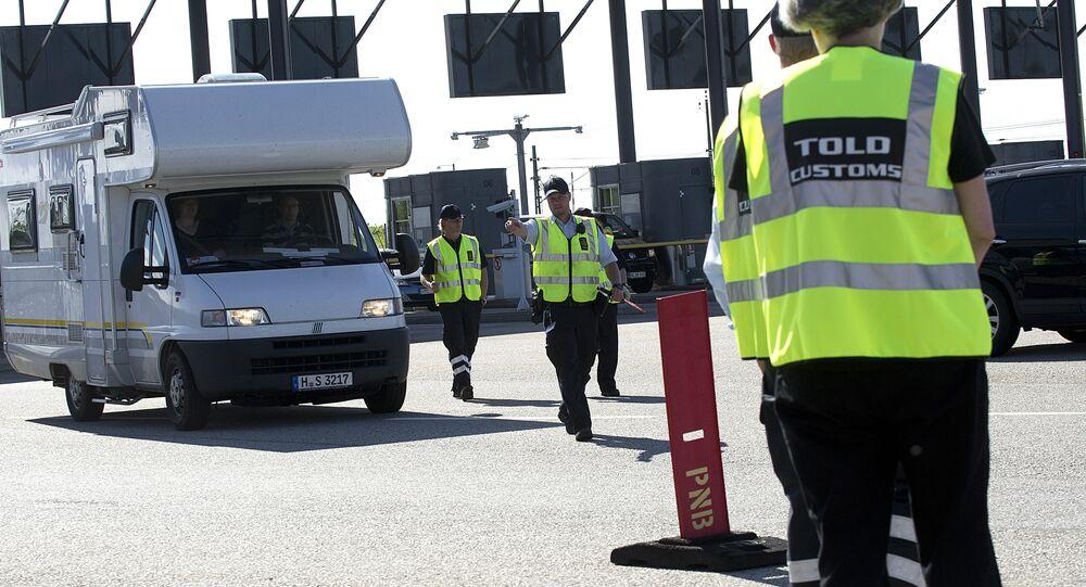 Danish custom officers start their work at the Oeresund Bridge border control between Denmark and Sweden on July 5, 2011