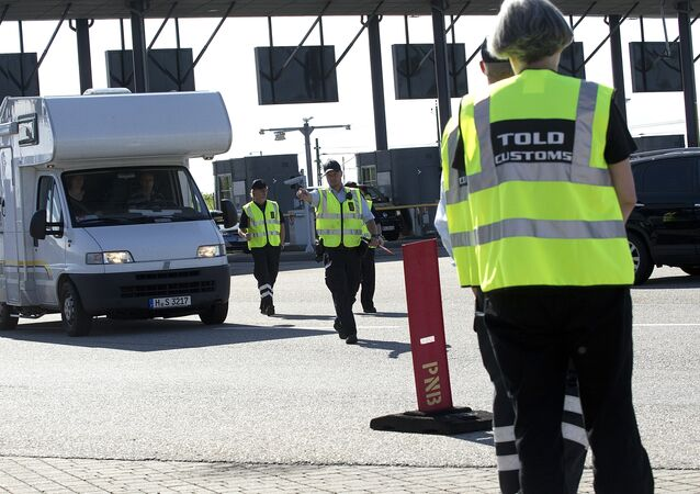 Danish custom officers start their work at the Oeresund Bridge border control between Denmark and Sweden on July 5, 2011