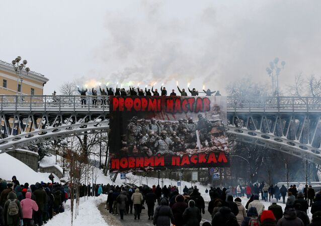 Activists burn flares during a protest against the extension of police authority and power in central Kiev, Ukraine, November 14, 2016