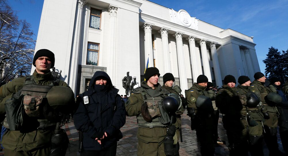 Members of the National Guard stand guard during a rally of depositors of failed Ukrainian banks who demand compensation of their deposits, in front of the parliament building in Kiev, Ukraine, November 15, 2016