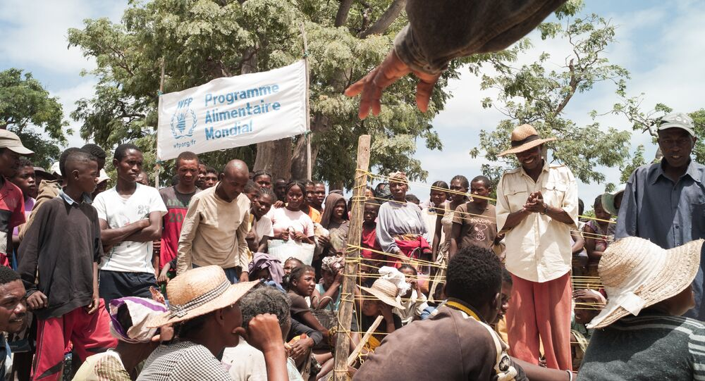 This picture taken on March 4, 2015 shows people waiting for a distribution of bags of rice by World Food Program (WFP) staff in the village of Berano, in the Tsihombe district of southern Madagascar