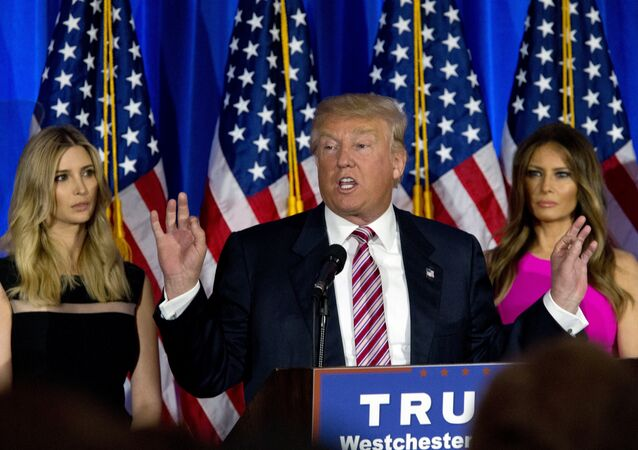 Donald Trump is joined by his daughter Ivanka, left, and wife Melania as he speaks during a news conference at the Trump National Golf Club Westchester, Tuesday, June 7, 2016, in Briarcliff Manor, NY.
