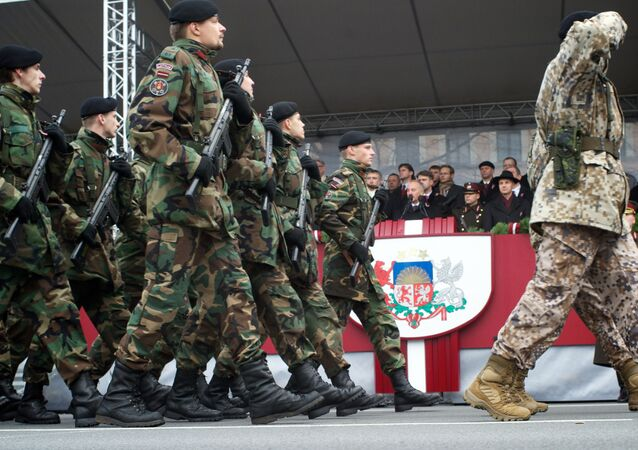Latvian soldiers march during a military parade on November 18 (File)