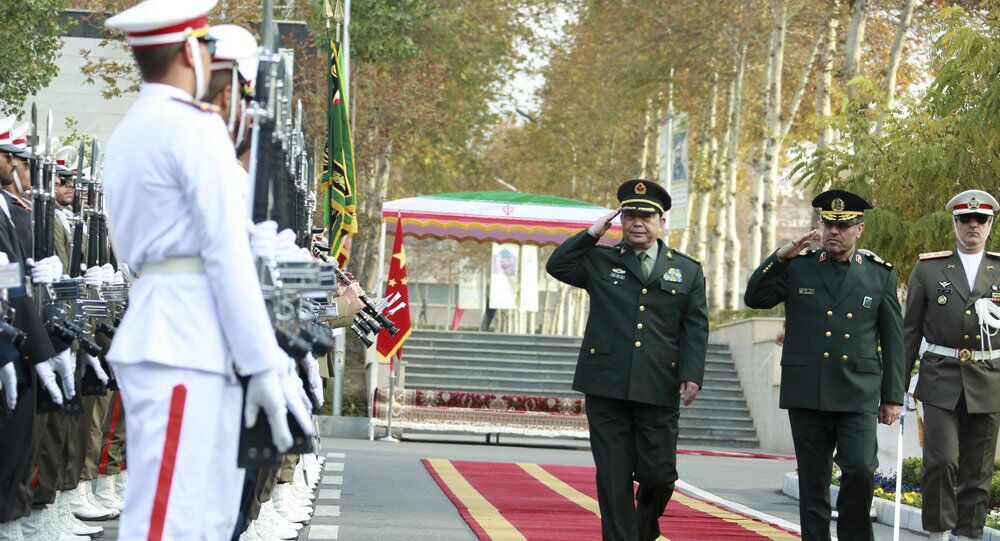 In this picture released by the Iranian Defense Ministry, Chinese Defense Minister Chang Wanquan, center, reviews an honor guard while he is welcomed by his Iranian counterpart Gen. Hossein Dehghan, in Tehran, Iran, Monday, Nov. 14, 2016