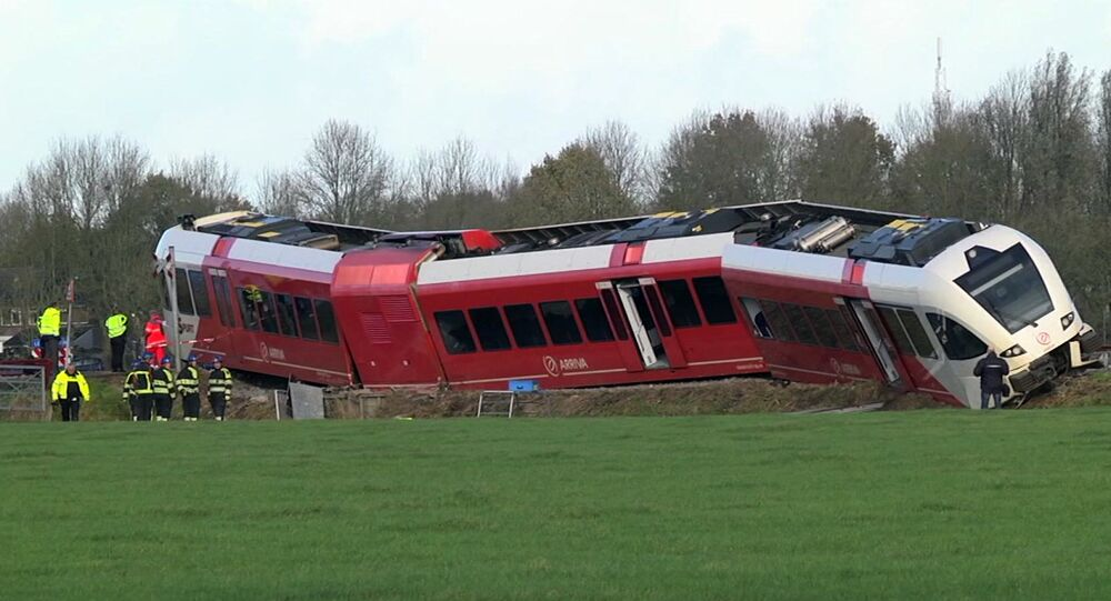 In this frame grab taken from video, emergency services attend the scene of a train derailment, near Winsum, Northern Netherlands, Friday, Nov. 18, 2016