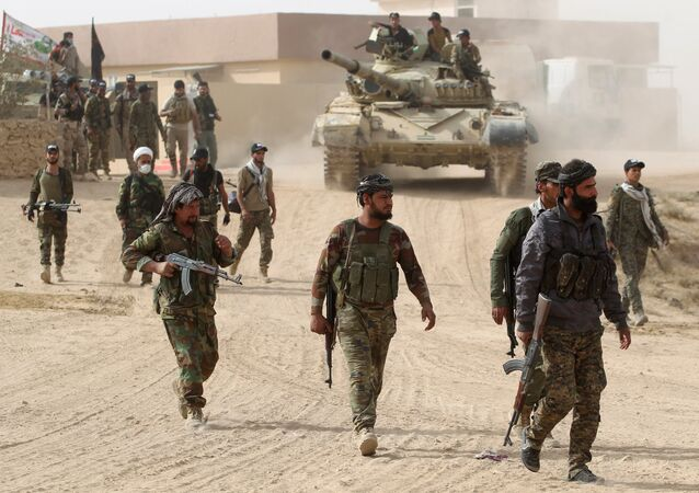 Shiite fighters from the Hashed al-Shaabi (Popular Mobilisation Units) enter the village of Abu Shuwayhah, south of jihadist-held Mosul, on November 1, 2016