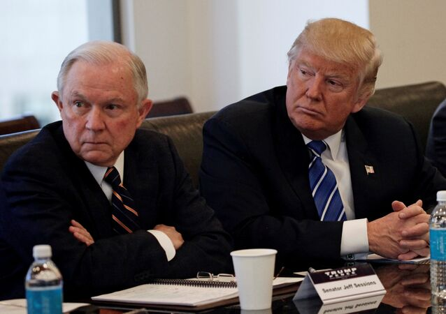 Donald Trump sits with U.S. Senator Jeff Sessions (R-AL) at Trump Tower in Manhattan, New York, U.S., October 7, 2016