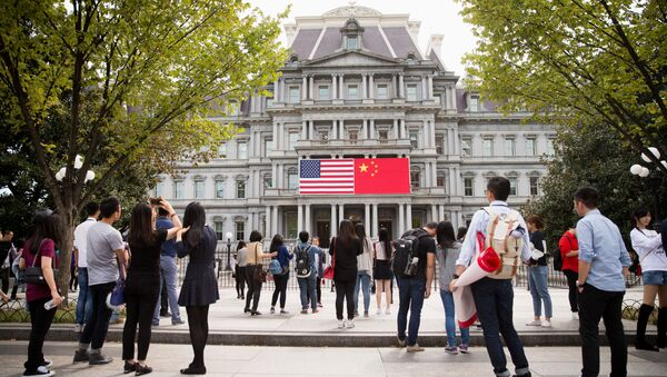 China's flag is displayed next to the American flag on the side of the Old Executive Office Building on the White House complex in Washington (File) - Sputnik International