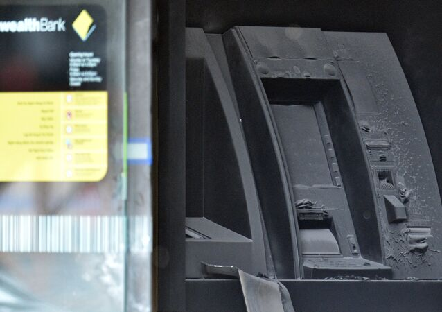 An electronic cash machine is burned at a branch of the Commonwealth Bank after a fire injured customers in Melbourne, Australia November 18, 2016