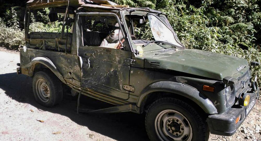 Bullet marks are seen on a damaged army vehicle at Pengeri in Assam's Tinsukia district on November 19, 2016, following an ambush attack by armed militants