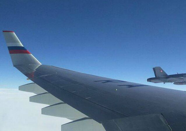 On Friday, military aircraft with the Swiss insignia have escorted the plane with the Russian delegation, including journalists and Alexander Fomin