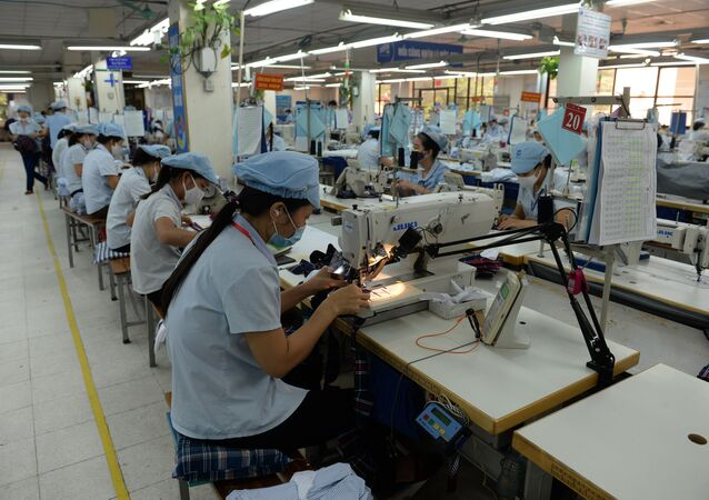 This picture taken on October 20, 2015 shows female workers on a production line at the Garment 10 Company in the outskirts of Hanoi