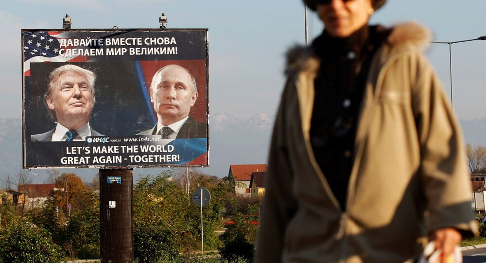 A woman passes a billboard showing a pictures of US president-elect Donald Trump and Russian President Vladimir Putin in Danilovgrad, Montenegro, November 16, 2016