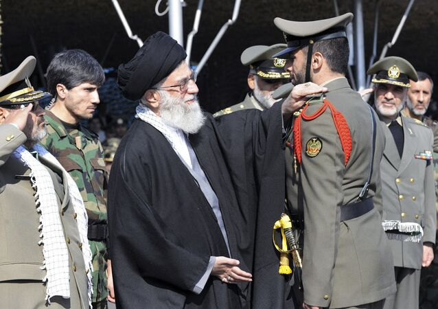 In this Thursday, Nov. 10, 2011 file photo released by the official website of the Iranian supreme leader's office, Iranian supreme leader Ayatollah Ali Khamenei, center, confers a rank to an unidentified member of Iran's army during a ceremony, in Tehran, Iran