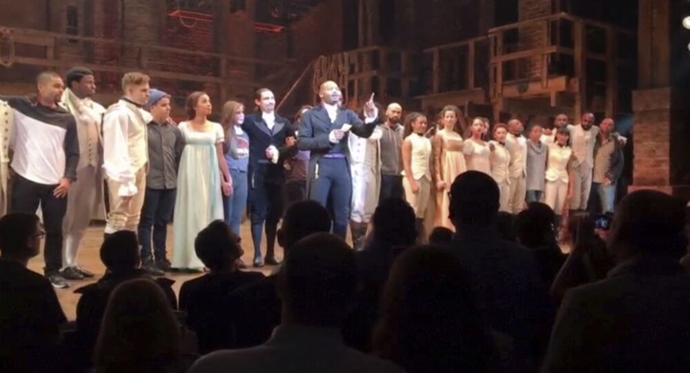 In this image made from a video provided by Hamilton LLC, actor Brandon Victor Dixon who plays Aaron Burr, the nation's third vice president, in Hamilton speaks from the stage after the curtain call in New York, Friday, Nov. 18, 2016. Vice President-elect Mike Pence is the latest celebrity to attend the Broadway hit Hamilton, but the first to get a sharp message from a cast member from the stage. (Hamilton LLC via AP)