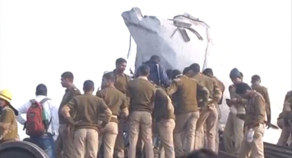 Police officers and people gather at the site where a train derailed in Kanpur, in India's northern state of Uttar Pradesh, in this still image taken from video November 20, 2016.