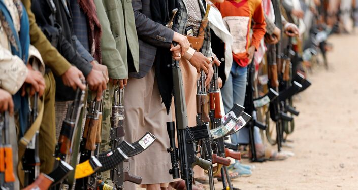 Tribesmen hold their weapons as they attend a tribal gathering to show support to the Houthi movement in Sanaa, Yemen November 10, 2016.