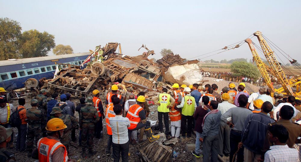 Rescue workers search for survivors at the site of a train derailment in Pukhrayan, south of Kanpur city, India