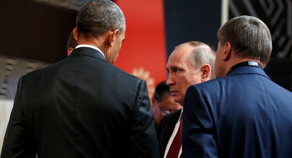 U.S. President Barack Obama talks with Russian President Vladimir Putin at the APEC Economic Leaders' Meeting in Lima, Peru