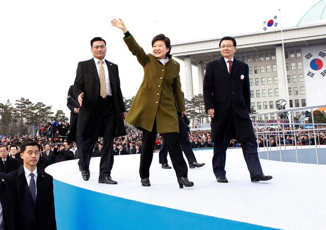 South Korea's new President Park Geun-hye (C) leaves after her inauguration at the parliament in Seoul, South Korea February 25, 2013.