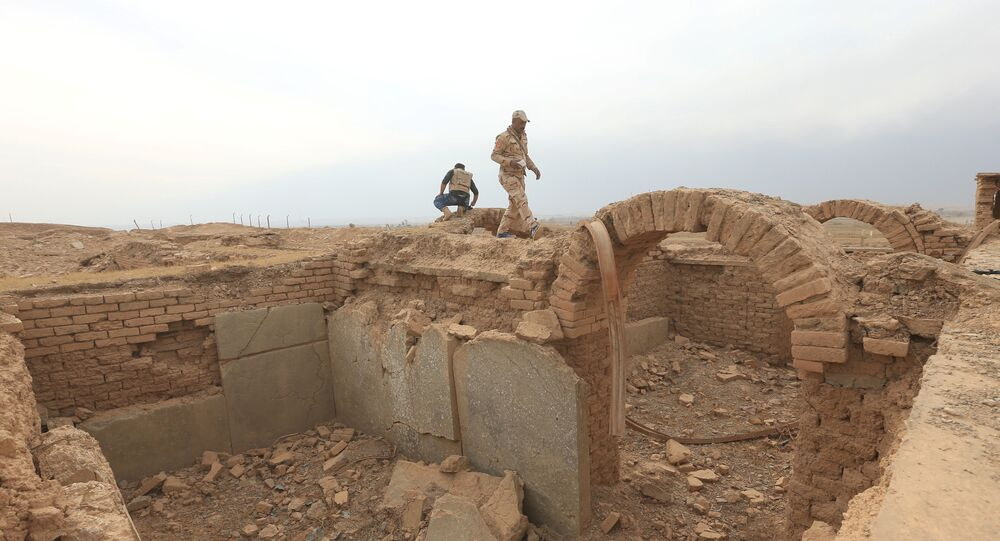 A member of Iraqi army walks at the remains of wall panels and colossal statues of winged bulls, destroyed by Islamic State militants in the Assyrian city of Nimrud eastern bank of the Tigris River, south of Mosul, Iraq, November 16, 2016.