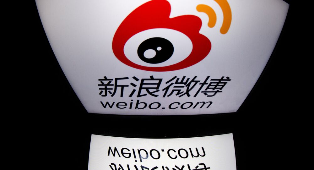 The chinese app Weibo's logo is displayed on a tablet in Paris. (File)