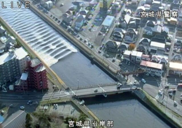 A tidal surge is seen in Sunaoshi River after tsunami advisories were issued following an earthquake in Tagajo, Miyagi prefecture, Japan November 22, 2016, in this video grab image released by Miyagi Prefectural Police via Kyodo