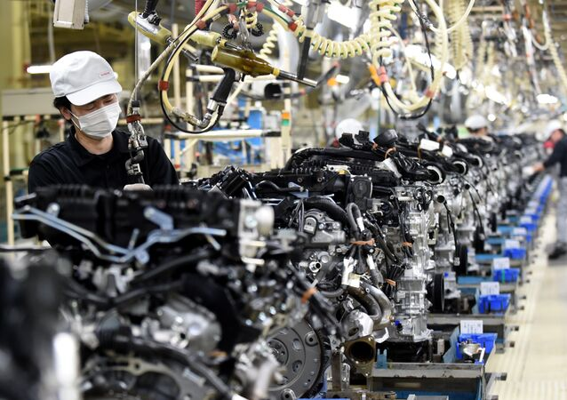 Employees work at the main assembly line of V6 engines at Iwaki Plant of Japan's Nissan Motor in Iwaki, Fukushima prefecture