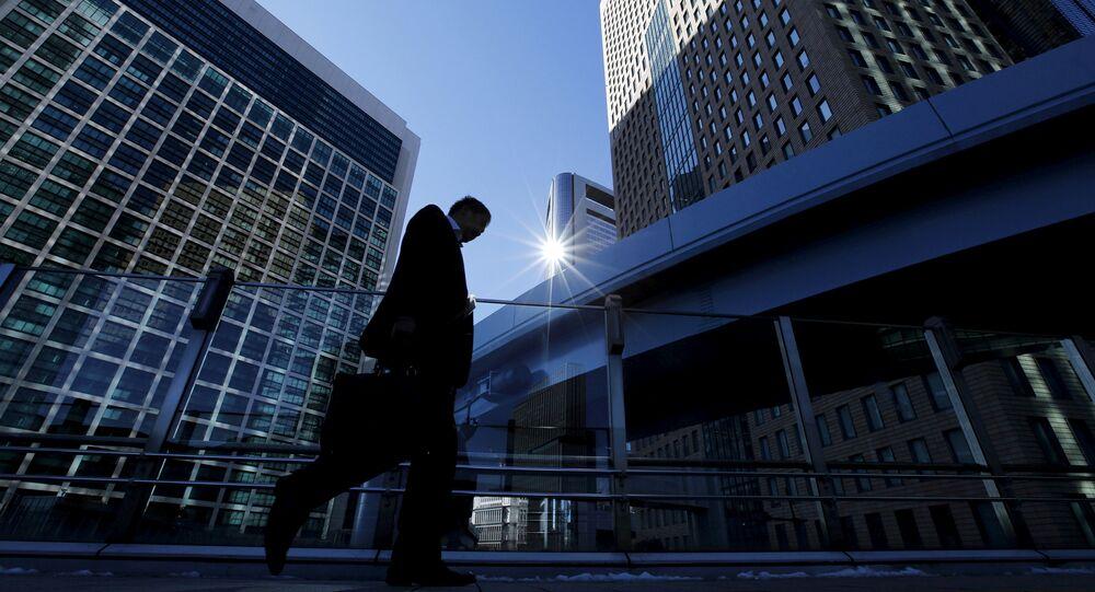 A businessman walks in Tokyo's business district, Japan