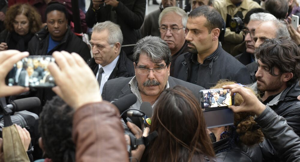 Salih Muslim Muhammad chairman of the PYD, the Syrian branch of the PKK answers journalists' questions as he arrives to pay tribute to the victims of the attacks claimed by Islamic State which killed at least 129 people and left more than 350 injured, on November 17, 2015 in front of the Bataclan theatrein Paris. (File)