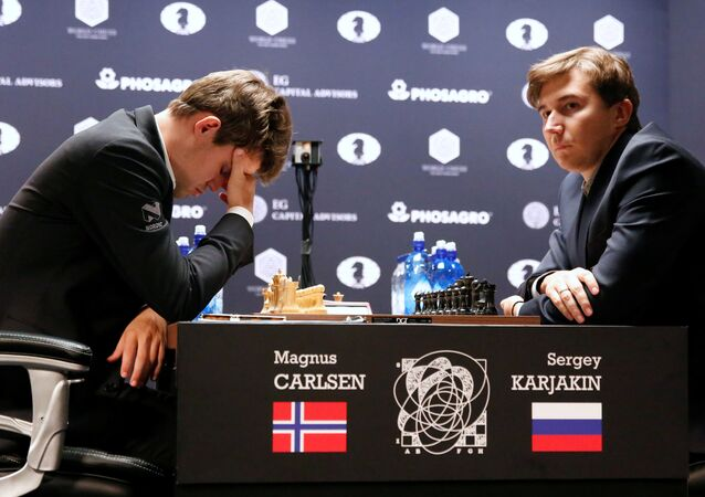 Magnus Carlsen, of Norway, reacts at his match with Sergey Karjakin, of Russia