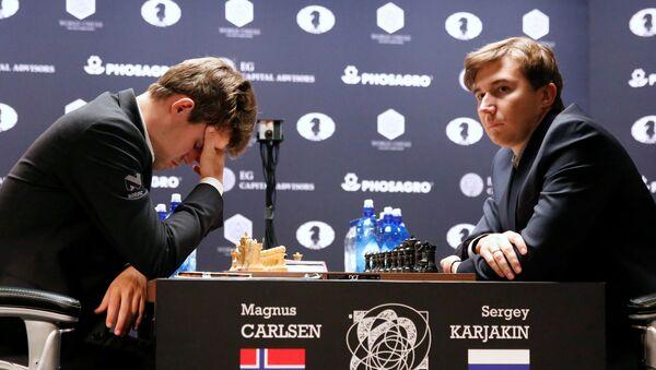 Magnus Carlsen, of Norway, reacts at his match with Sergey Karjakin, of Russia - Sputnik International