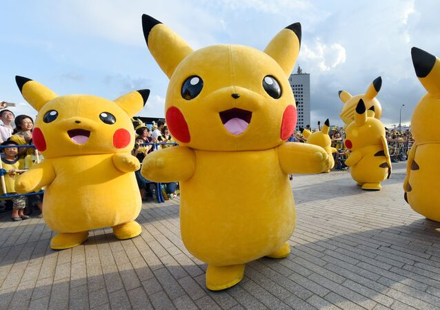 Dozens of people dressed up as Pikachu, the famous character of Nintendo's videogame software Pokemon, dance with fans as the final of a nine-day Pikachu Outbreak event takes place to attract summer vacationers in Yokohama, in suburban Tokyo, on August 16, 2015
