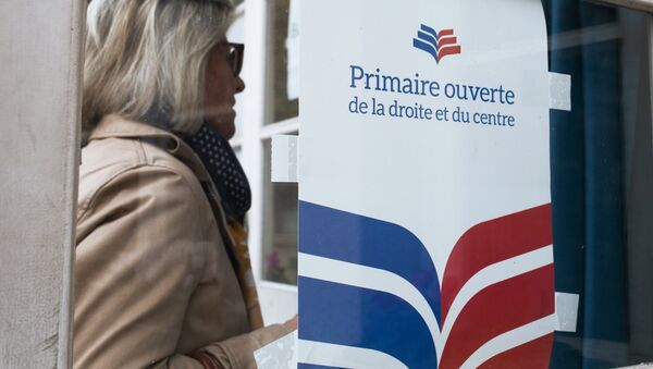 A woman near a polling station in Paris during the first round of the French center-right presidential primary election. An opposition candidate for the 2017 presidential election will be selected during the event - Sputnik International
