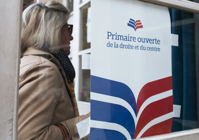 A woman near a polling station in Paris during the first round of the French center-right presidential primary election. An opposition candidate for the 2017 presidential election will be selected during the event